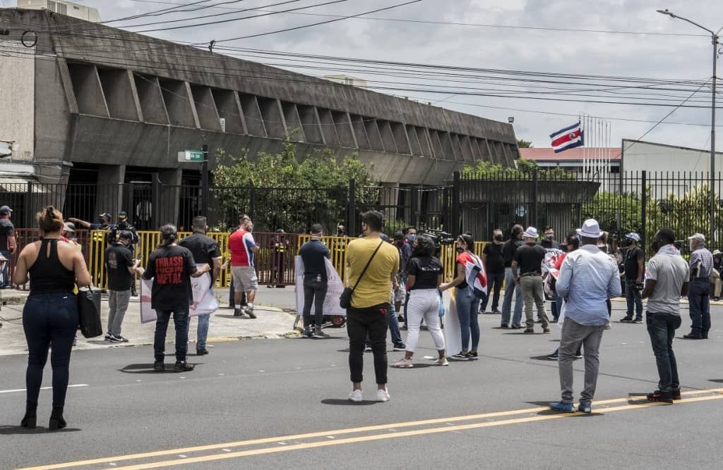 People take part in a protest in rejection of austerity policies promoted by the government to contain public spending amid the COVID-19 pandemic, in front of the presidential house in Costa Rica, San Jose, on July 23, 2020.