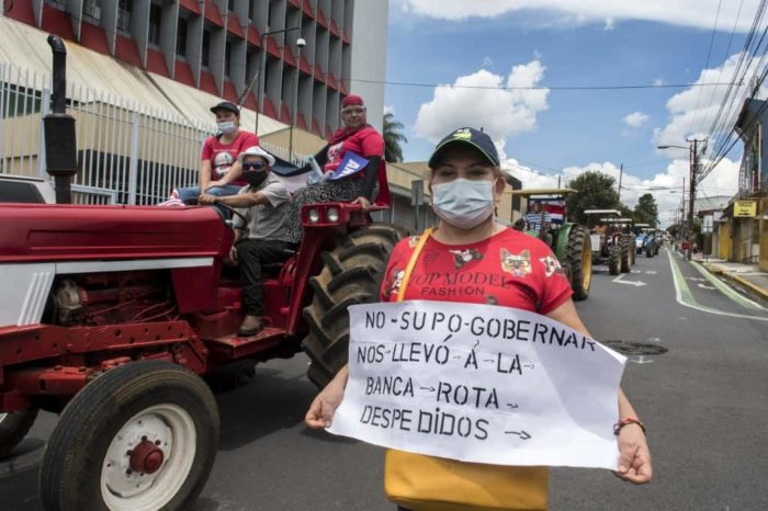 People take part in a protest in rejection of austerity policies promoted by the government to contain public spending amid the COVID-19 pandemic in San Jose, on July 27, 2020.