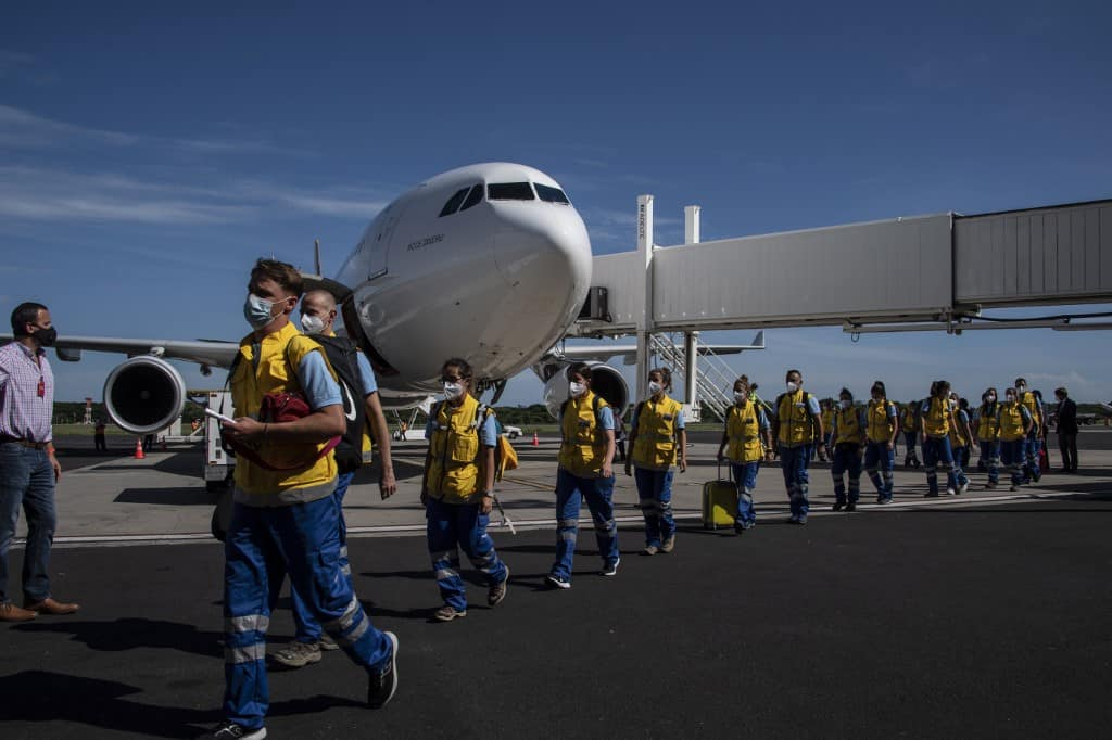 Volunteer doctors from Spain, Portugal, Argentina and Costa Rica, members of the SAMU Foundation, arrive at the Oscar Arnulfo Romero International Airport in Comalapa, El Salvador on July 29, 2020.