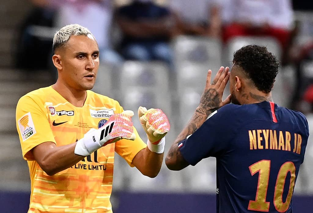 Paris Saint-Germain's Costa Rican Keylor Navas (L) and Paris Saint-Germain's Brazilian forward Neymar shake hands during a penalty shoot during the French League Cup final football match between Paris Saint-Germain vs Olympique Lyonnais at the Stade de France in Saint-Denis on July 31, 2020.