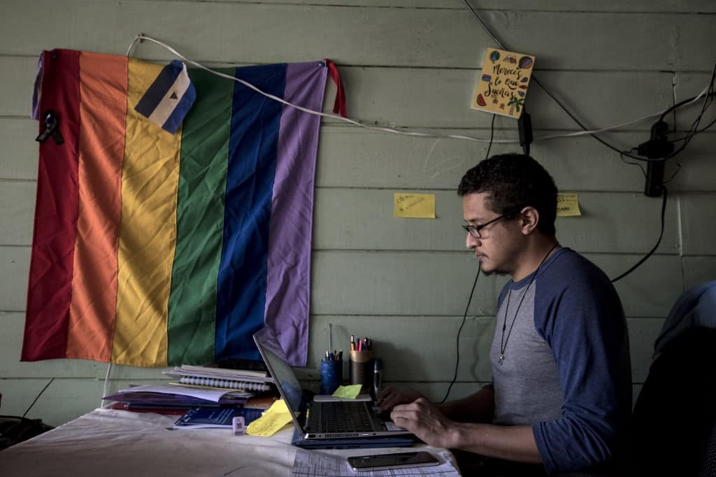 Nicaraguan Carlos Berrios works during an interview with AFP, at his house in San Jose on July 31, 2020. - Berrios, afraid for being a human rights activist of the LGBTI community, fled Nicaragua and moved to Costa Rica.