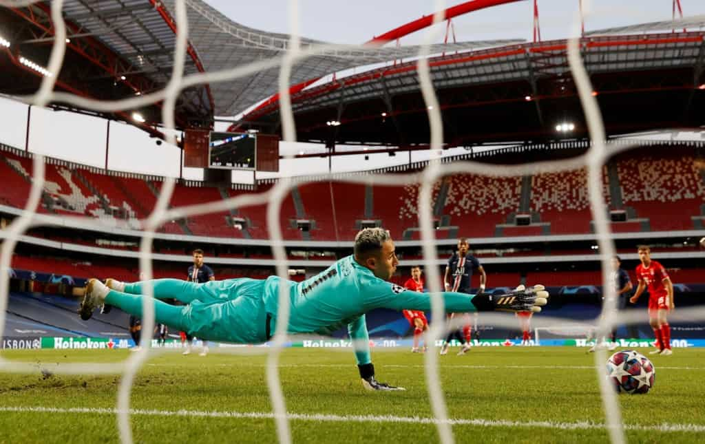 Paris Saint-Germain's Costa Rican Keylor Navas dives for a shot by Bayern Munich's Polish forward Robert Lewandowski during the UEFA Champions League final football match between Paris Saint-Germain and Bayern Munich at the Luz stadium in Lisbon on August 23, 2020.