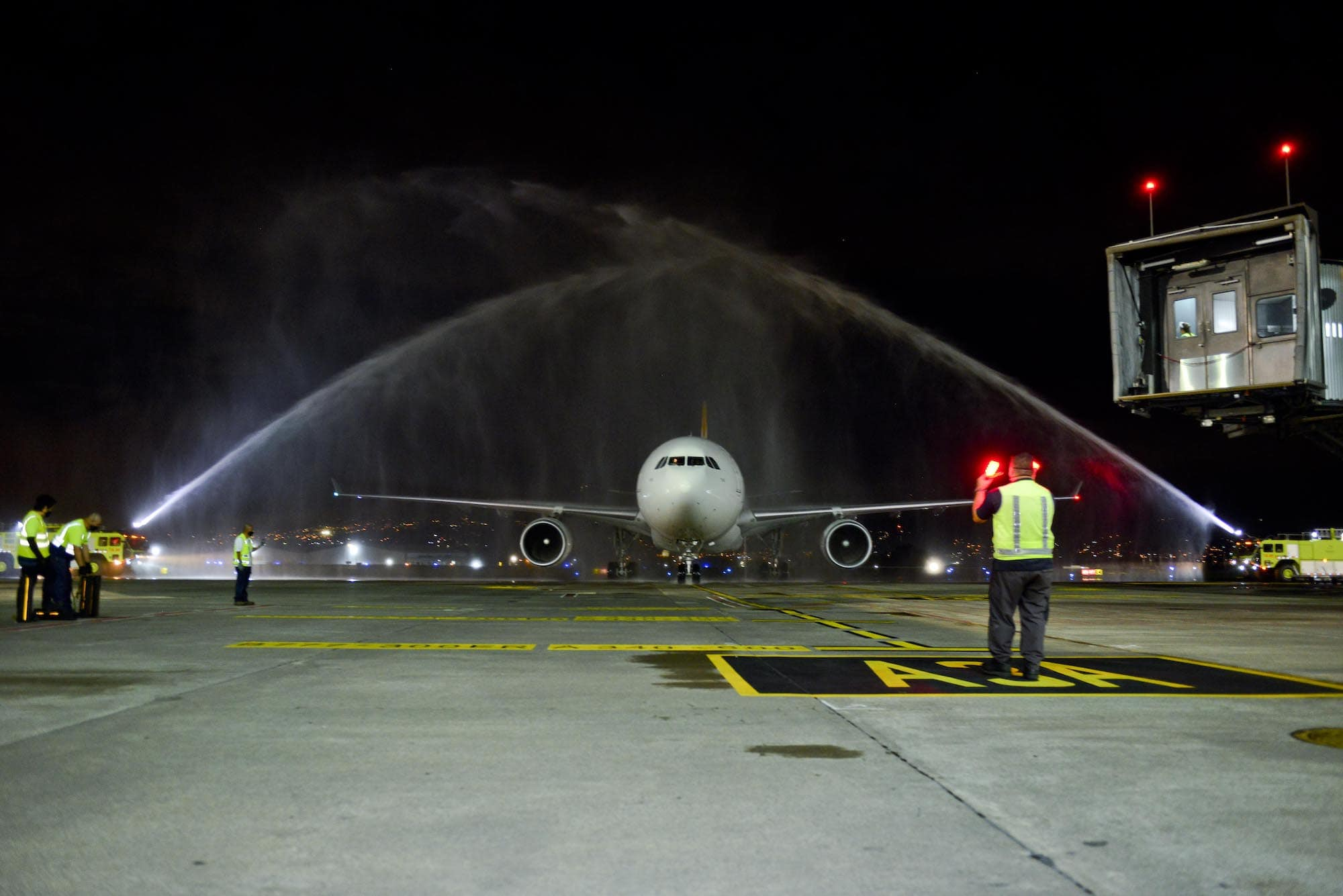 An Iberia A330-200 is welcomed with a water-cannon salute as Costa Rica welcomes the return of international tourists.