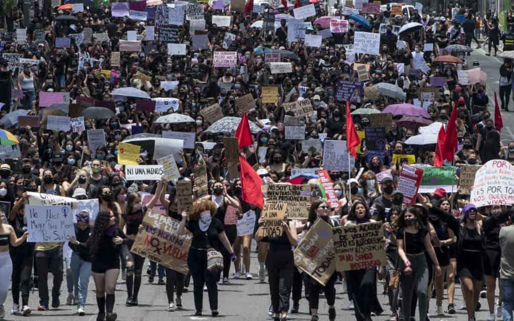People protest against femicides during a march in San José on September 6, 2020.