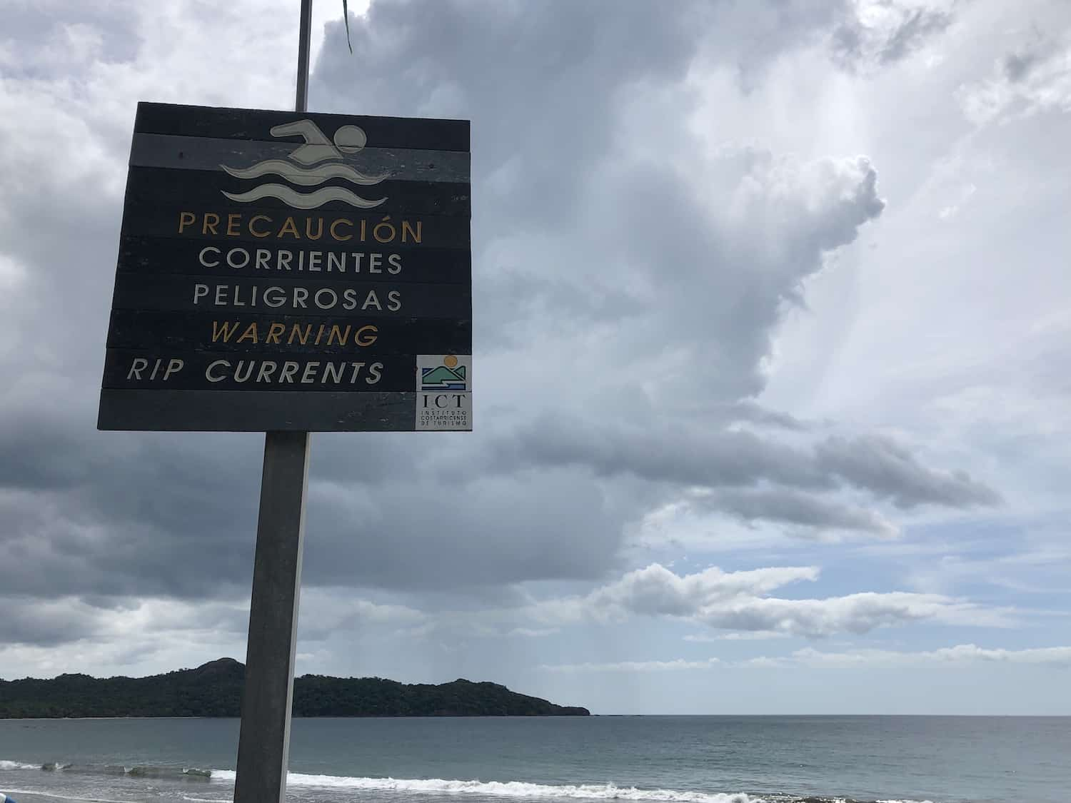 A sign warns swimmers of riptides at a beach in Costa Rica.