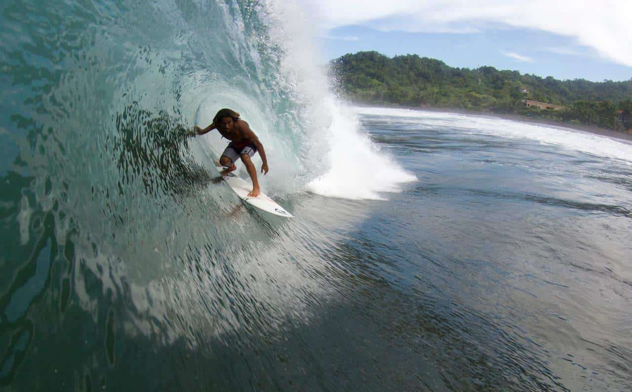 A surfer at Playa Hermosa, south of Jacó in Costa Rica.