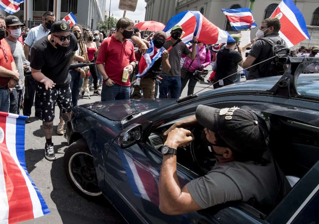 Demonstrators cut the traffic during a protest against the government's motion to increase taxes in order to reach a credit agreement with the International Monetary Fund (IMF), in San Jose, on September 30, 2020.