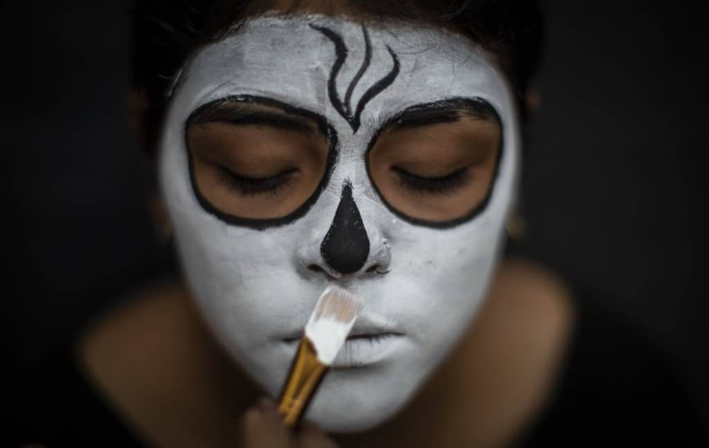 "A woman gets some make up before attending to ""Los Aguizotes"" festival in Masaya, Nicaragua, on October 23, 2020."