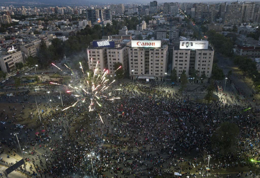 Aerial view showing demonstrators supporting the reform of the Chilean constitution waiting for the referendum official results at Plaza Italia square in Santiago on October 25, 2020.