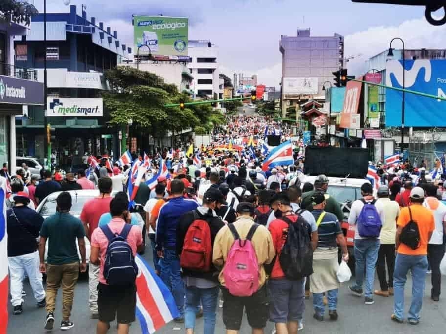 Protesters march in Costa Rica on October 12, 2020.