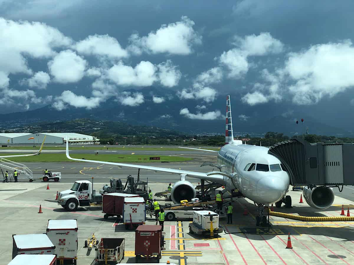 An airplane at the gate at Juan Sanatmaría International Airport, the busiest international airport in Costa Rica.