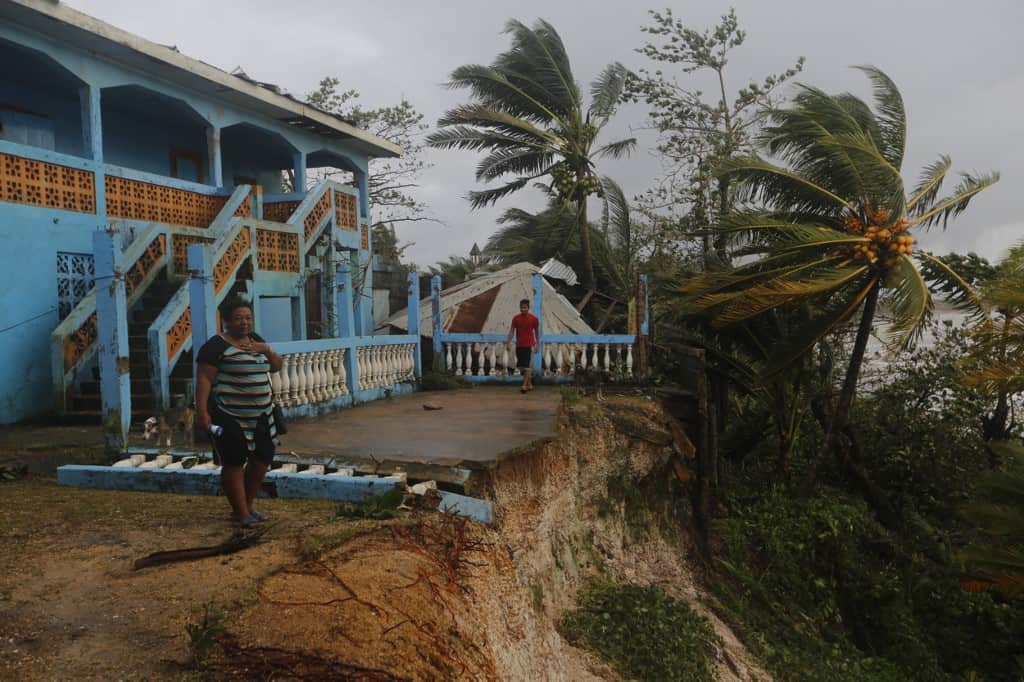 A woman reacts as she looks at damages caused by the passage of Hurricane Eta in Puerto Cabezas, Nicaragua, on November 4, 2020.