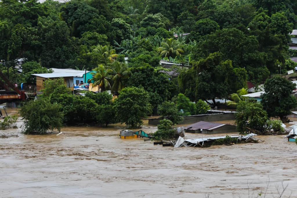 View of a flooded area due to the overflow of the Chamelecon river in La Lima municipality, Cortes department, northern Honduras, on November 18, 2020, following the passage of Hurricane Iota, now degraded to a tropical storm.