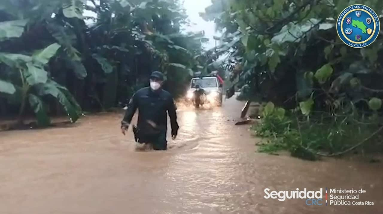 Authorities navigate a road flooded due to the indirect effects of Hurricane Eta in Costa Rica.
