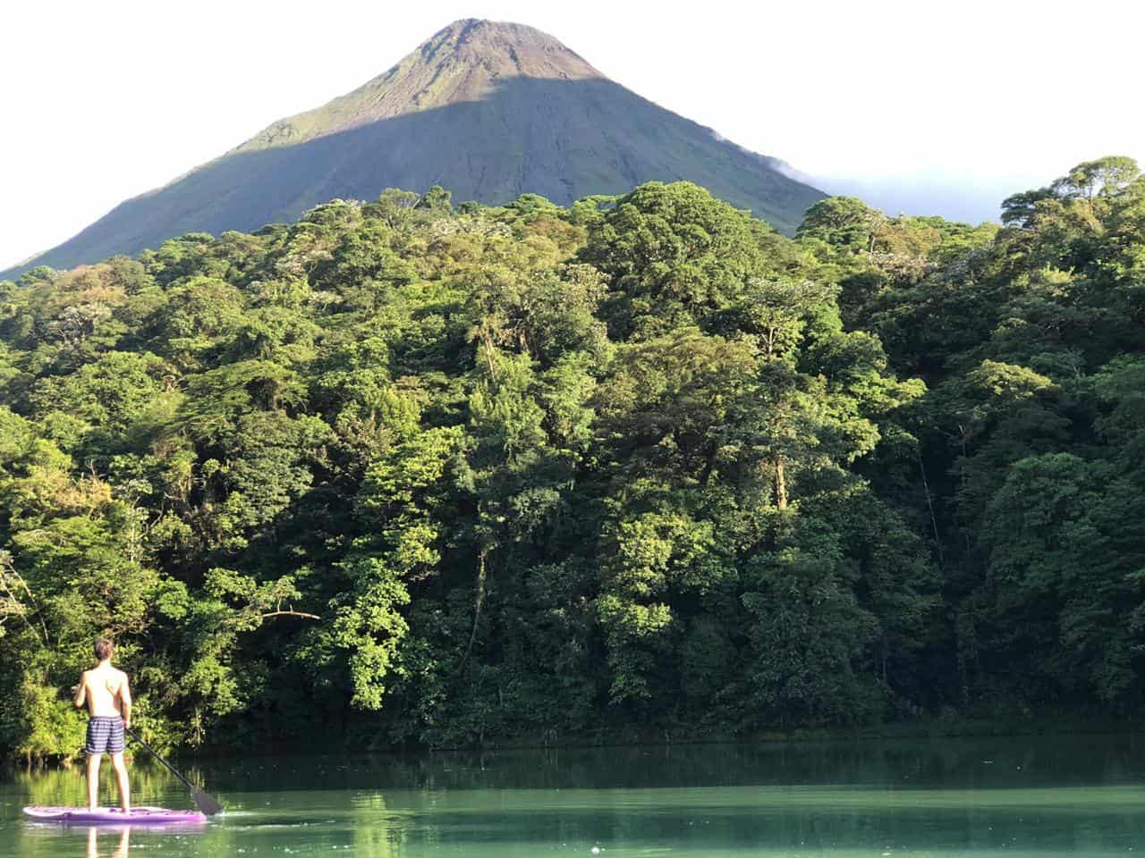 A tourist enjoys Lake Arenal in the shadows of the volcano by the same name.