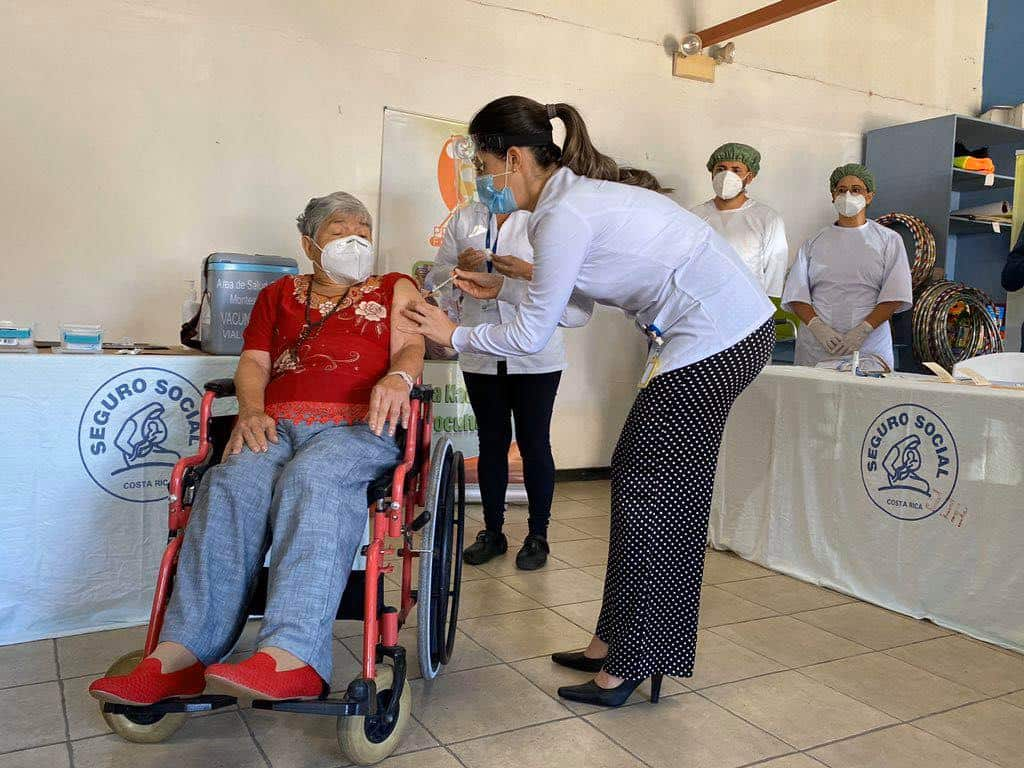 Elizabeth Castillo, 91, becomes the first person in Costa Rica to receive the coronavirus vaccine.