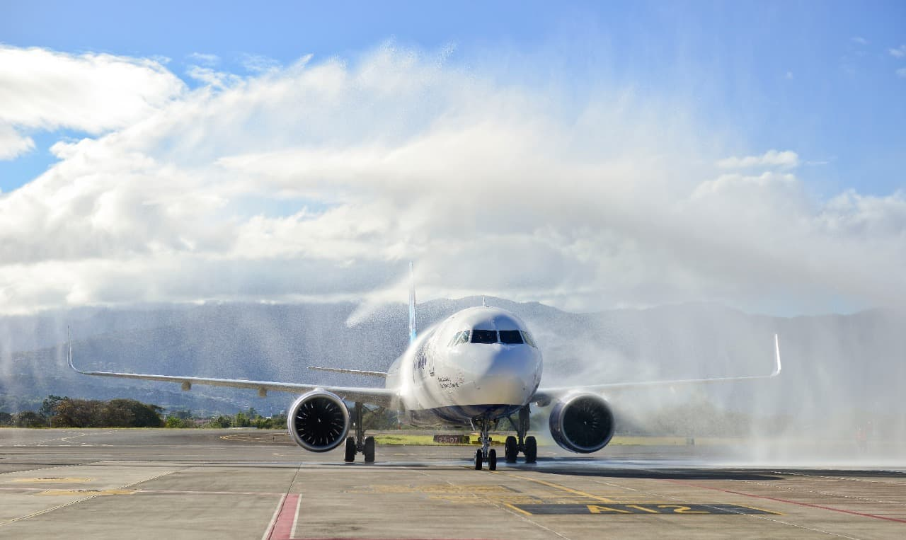 A JetBlue flight from Los Angeles receives a water-cannon salute at Juan Sanatamaría International Airport.