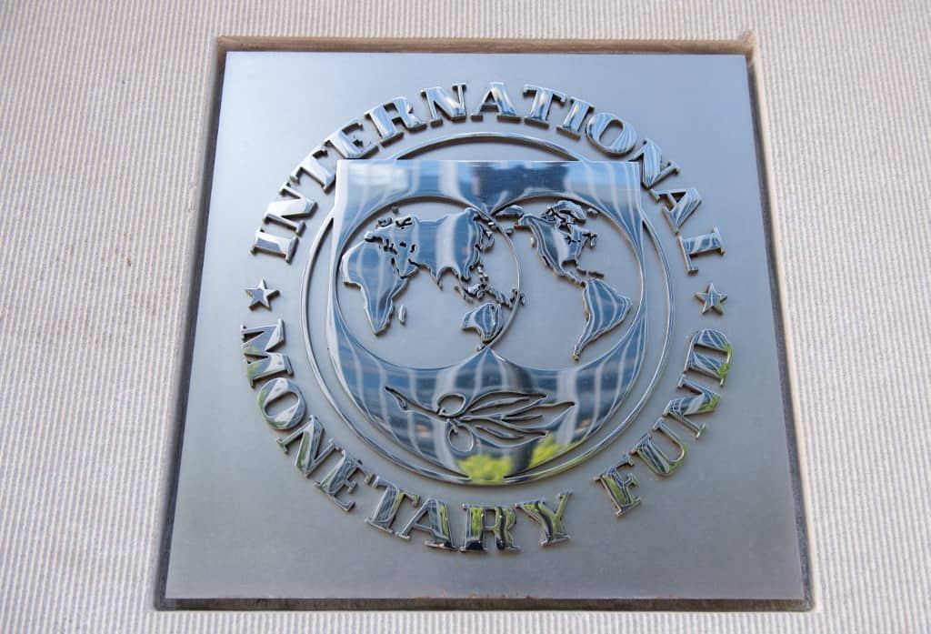 A plaque outside the headquarters of the International Monetary Fund (IMF) in Washington, DC.