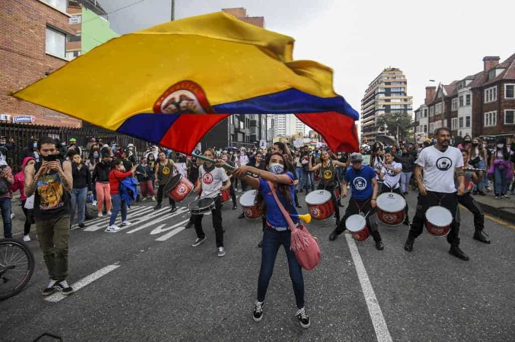 A woman waves a Colombian national flag during a protest against a tax reform proposed by Colombian President Ivan Duque's government in Bogota, on May 4, 2021.