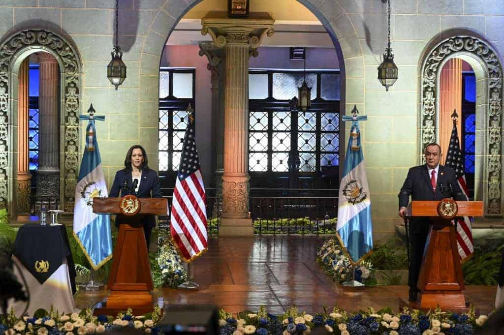 """US Vice-President Kamala Harris (L) and Guatemalan President Alejandro Giammattei deliver a joint press conference at the Culture Palace in Guatemala City on June 7, 2021. - Harris arrived in Guatemala Sunday, bringing a message of """"hope"""" to a region hammered by Covid-19 and which is the source of most of the undocumented migrants seeking entry to the United States."""
