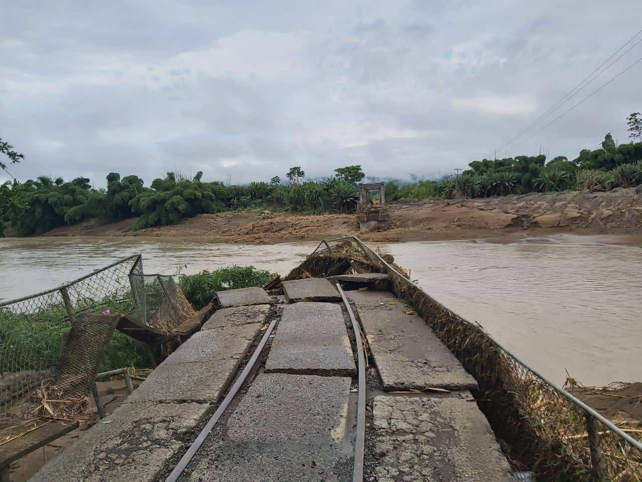 The Atalanta railway bridge in Rio Estrella, which collapsed due to debris in the swollen river.
