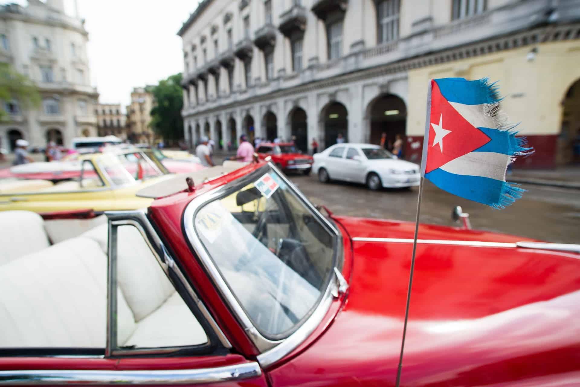 The Cuban flag on a car in Havana.
