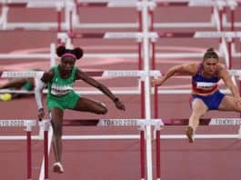 USA's Christina Clemons (L) competes to first place ahead of third-placed Costa Rica's Andrea Carolina Vargas the women's 100m hurdles semi-finals during the Tokyo 2020 Olympic Games at the Olympic Stadium in Tokyo on August 1, 2021.